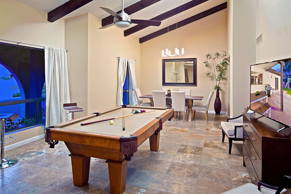 Fun game room with huge TV and pool table!