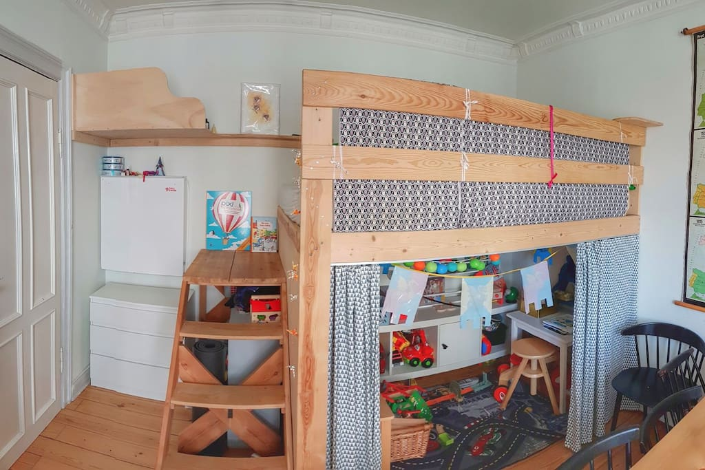 Elevated double bed + baby changing area to the left (folds out) + playing area under the bed