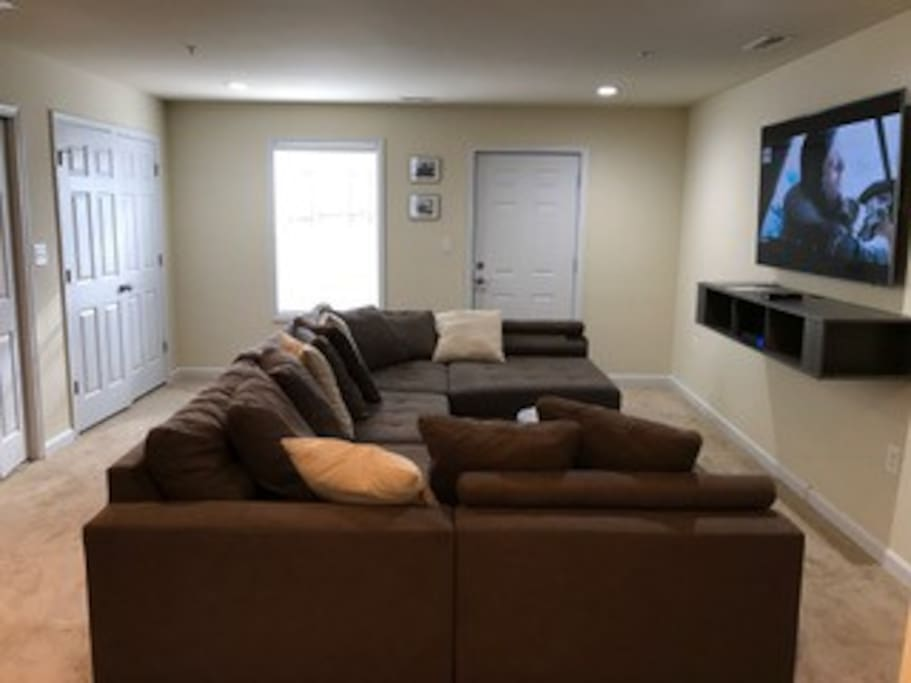Large sectional couch in the living room- 70' inch Samsung with HBO GO, Netflix (Ultra Package) and Xfinity
