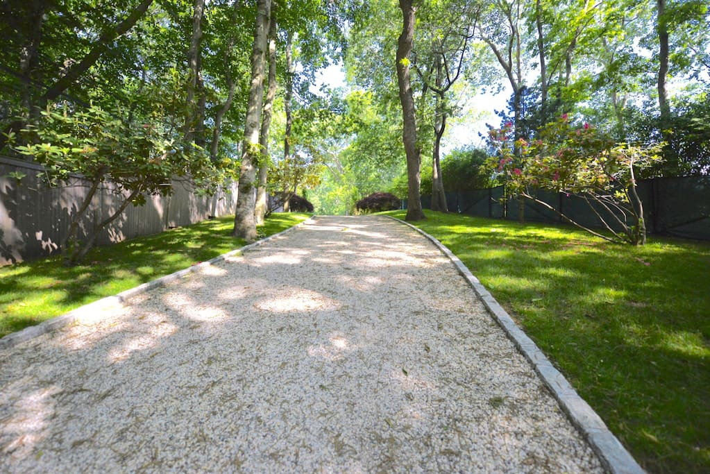 Long private landscaped drive
