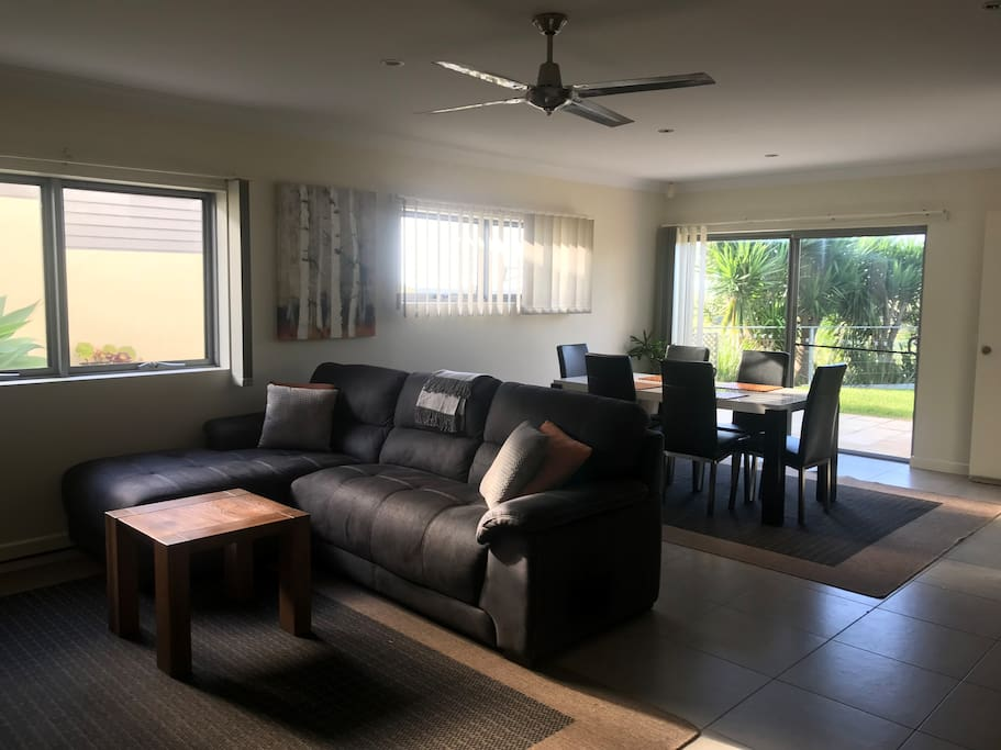 Spacious lounge and dining area. Tiled floors with floor rugs. Gas heating and ceiling fans