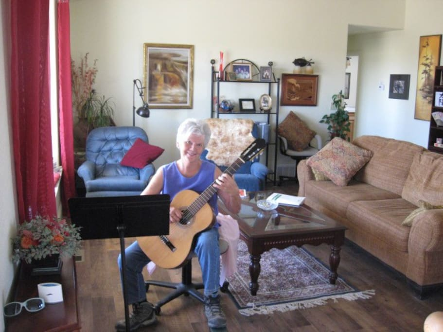 In my living room, playing guitar