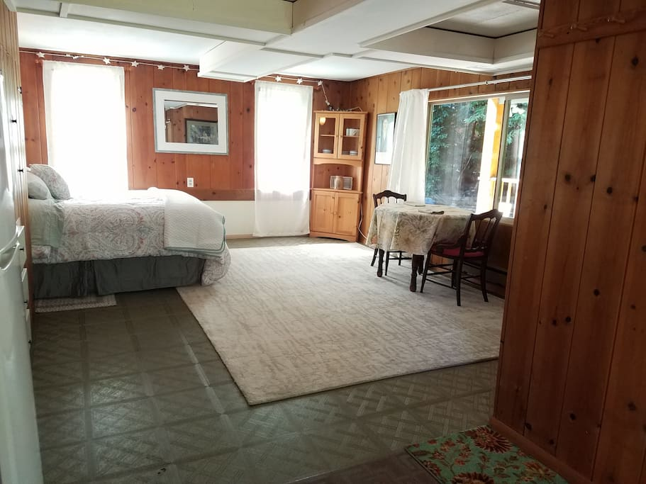 View from the kitchenette of sleeping area and dining table. The corner hutch holds all of your dishes.