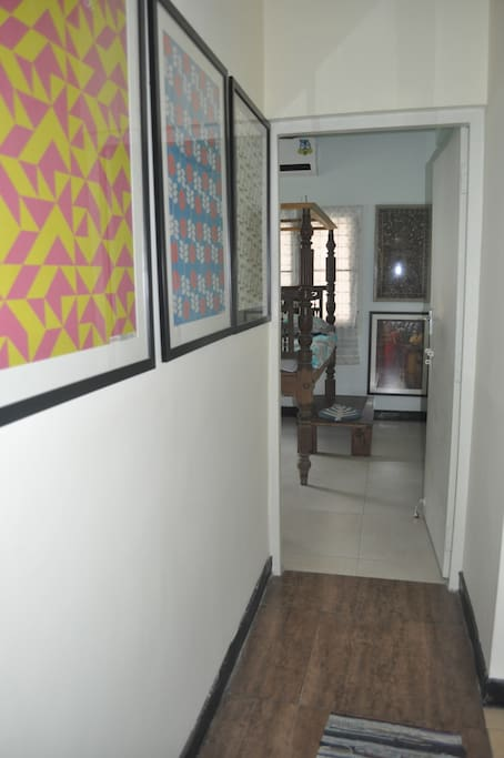 The corridor leading to your room decorated with framed posters