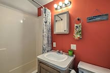The full bathroom offers a shower-tub combo!