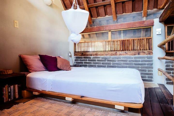 Mezzanine bedroom space with queen size bed