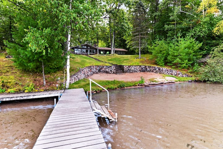 Lake-view house & bunkhouse w/ furnished patio, kitchens, boathouse - dogs OK!
