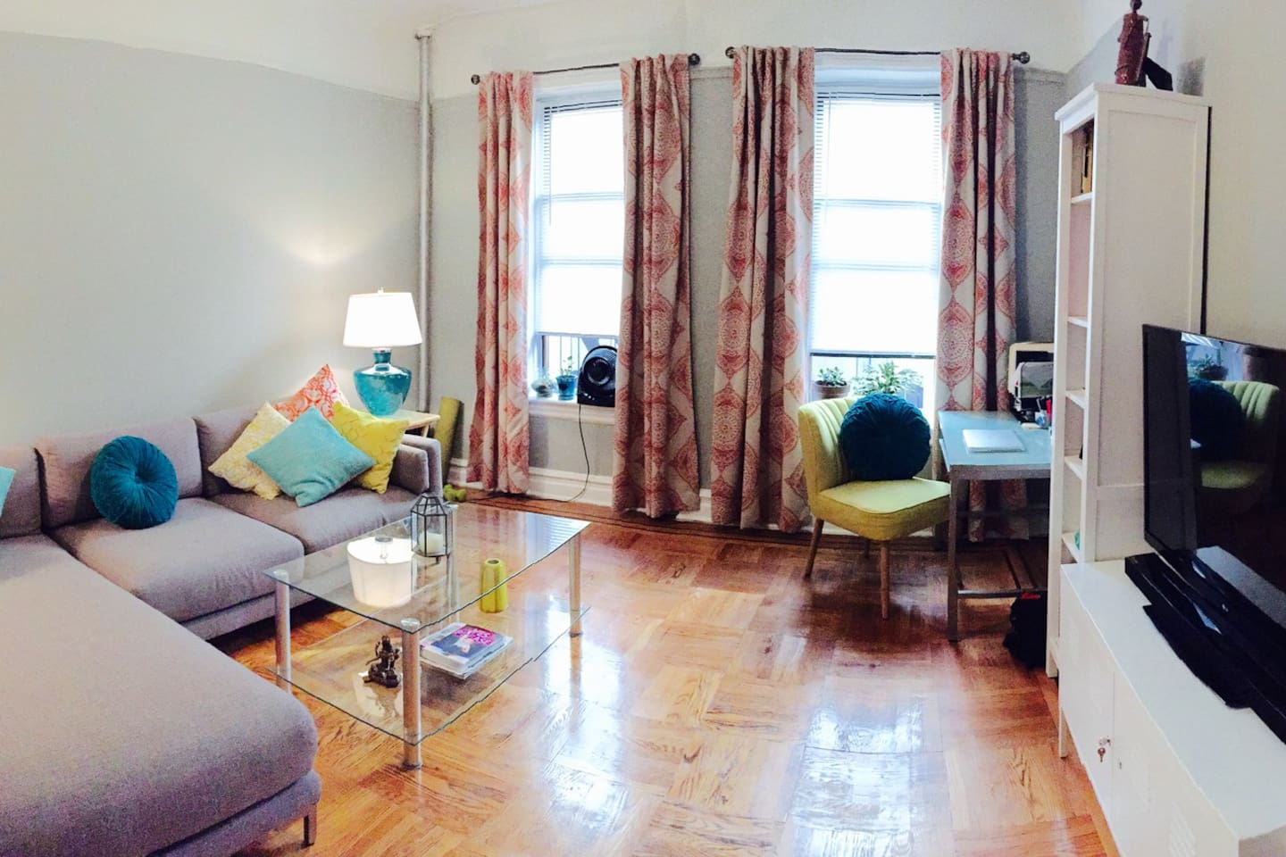 Panoramic of the living room with art, comfortable sofa and lovely natural light