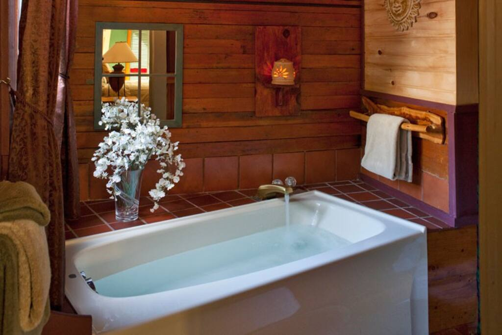 Relax in a jetted soaking tub. This private bathroom also has a separate shower.