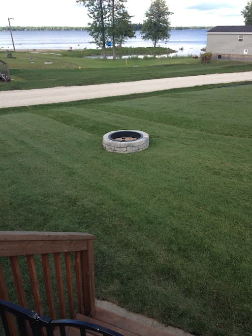 To the left of the fire pit is a huge grass field for playing sports or flying kites