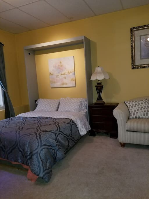 Same guests private queen size murphy bed in the bedroom
