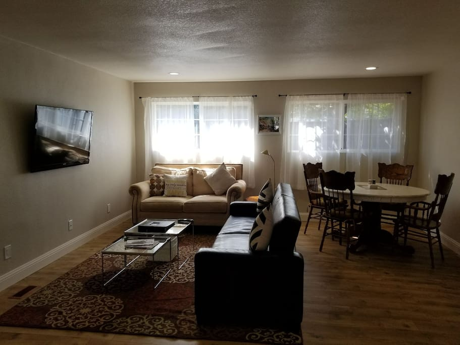 Large Bright and Airy Living Room.  New comfy couches and a table for four to enjoy the sunshine.  Sofa also turns to a double bed.