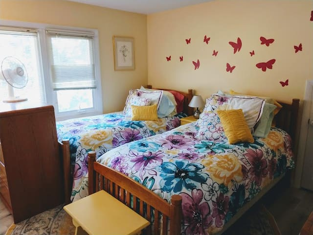 Bedroom has 2 twin beds and 2 dressers as well as a large closet with space for longer stays too