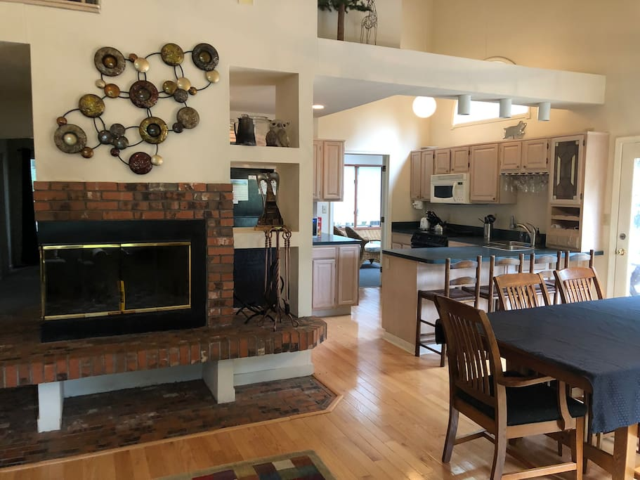 Main room with fireplace and view to kitchen