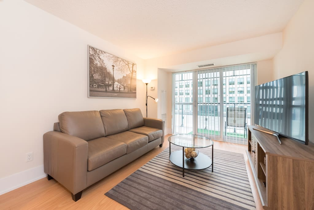 Living room of skydome central condo with big TV
