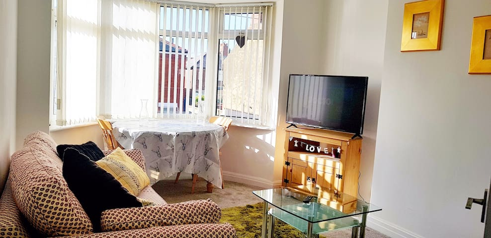 """Dining table semi-extended and 42"""" Flat screen T.V"""