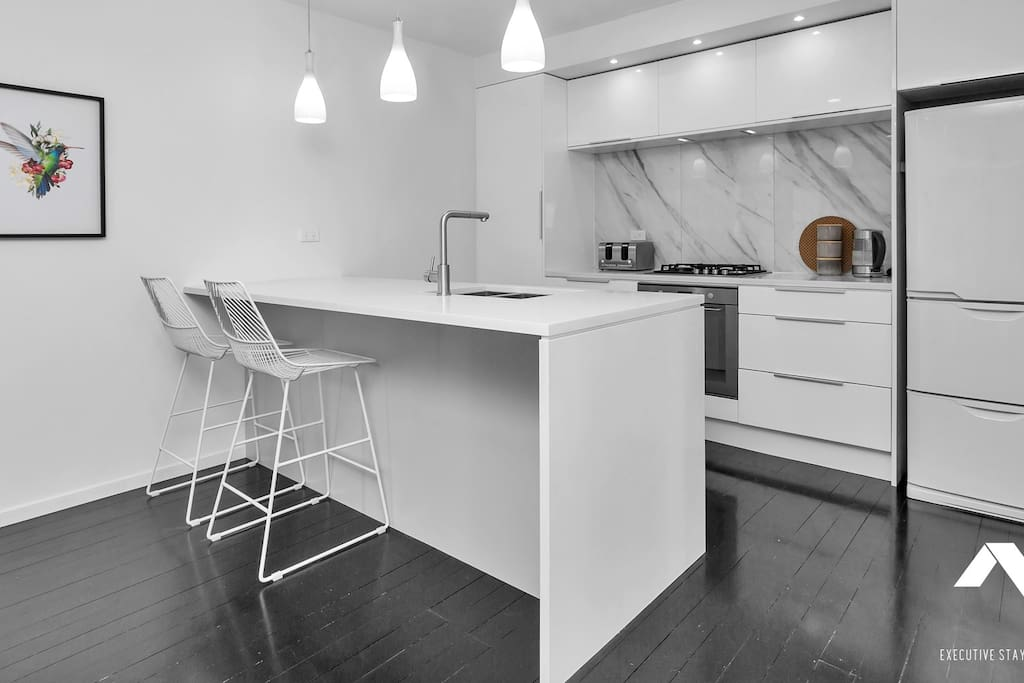 Cook up a storm in the fully equipped, modern kitchen with gas cooktop, oven, dishdrawer and fridge
