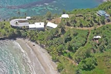 Two Bays is behind and above Cabier Ocean Lodge on the top right of aerial view