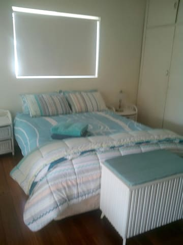 Main bedroom with queen bed and large ensuite