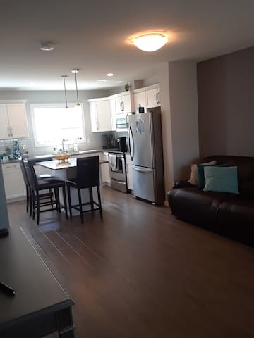 Main living area -shared space. Fridge, microwave, dishes/utensils, and a coffee pot