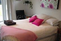 Seperate bedroom with queen bed