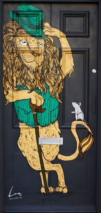 The front door to this  apartment features a piece of art by renowned local artist Alex Lucas
