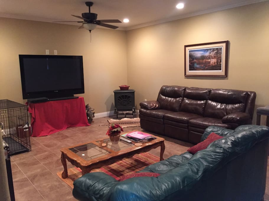 Interior living room with large screen plasma tv and gas fireplace.
