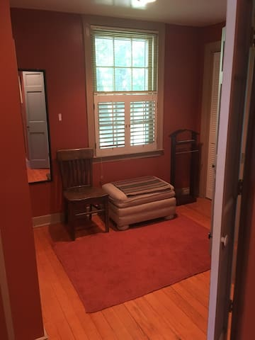 Large dressing room attaches the bedroom to the bathroom.