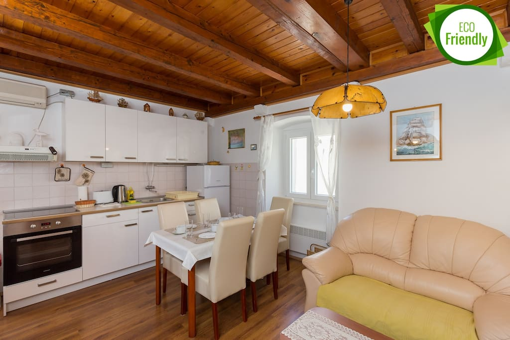 Fully equipped kitchen with dining area and a living room with a sofa