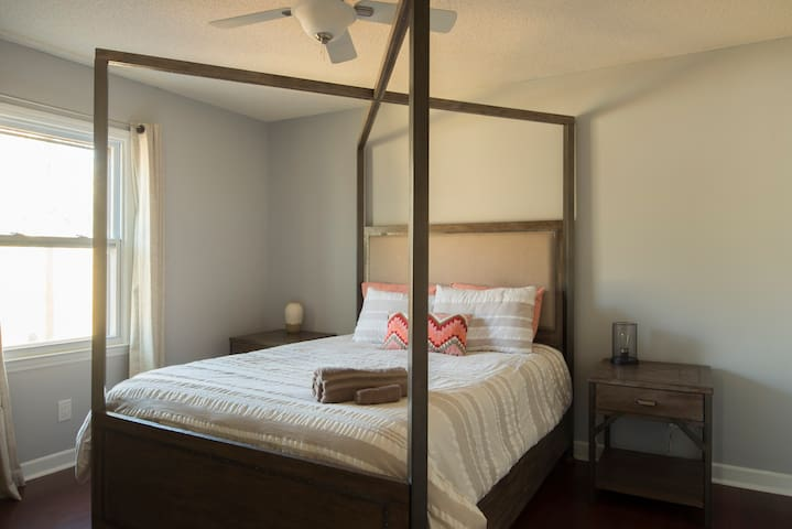 3rd bedroom with a queen sized bed and 2 closets.