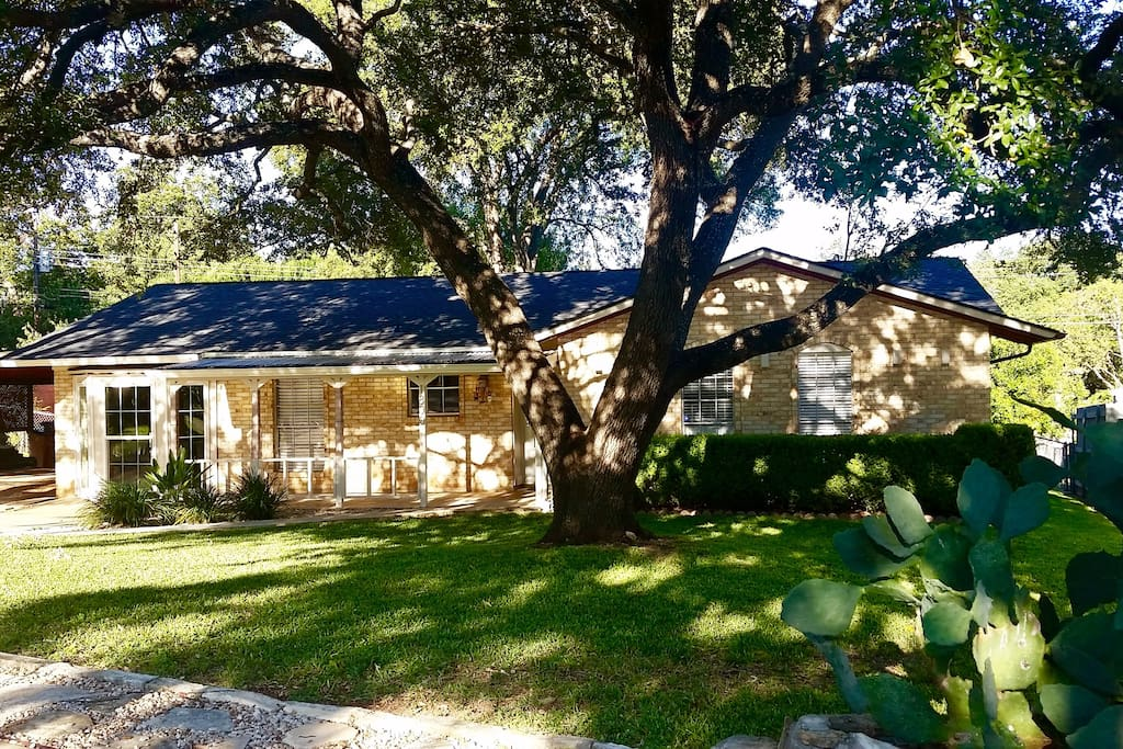Emerge Yourself Austin Style in an Authentic Austin Stone Home & Historic Oak Trees....Right Here -  Where You Need To Be!