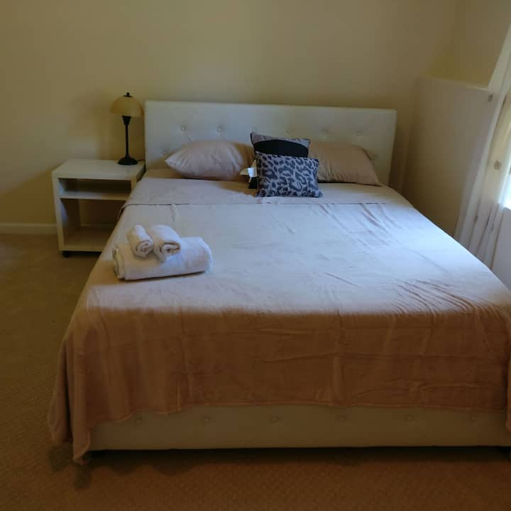 Single bedroom with shared bathroom and kitchen