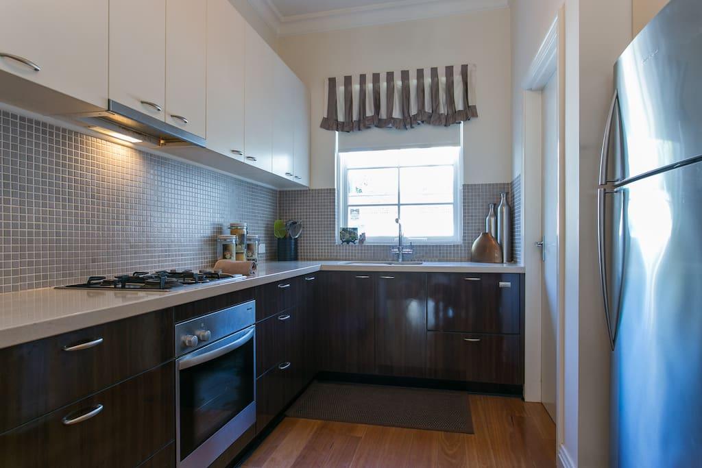Modern kitchen with granite bench tops & concealed dishwasher