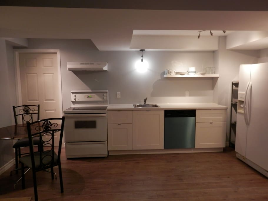 Kitchen with dishwasher, stove, microwave & side by side fridge/freezer