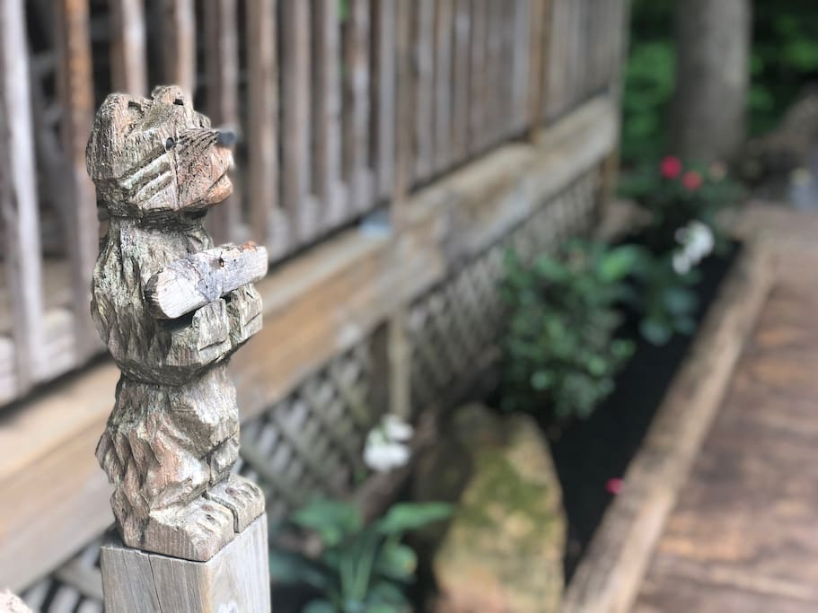 This Smoky mountain bear awaits your arrival on the porch of Camp View.