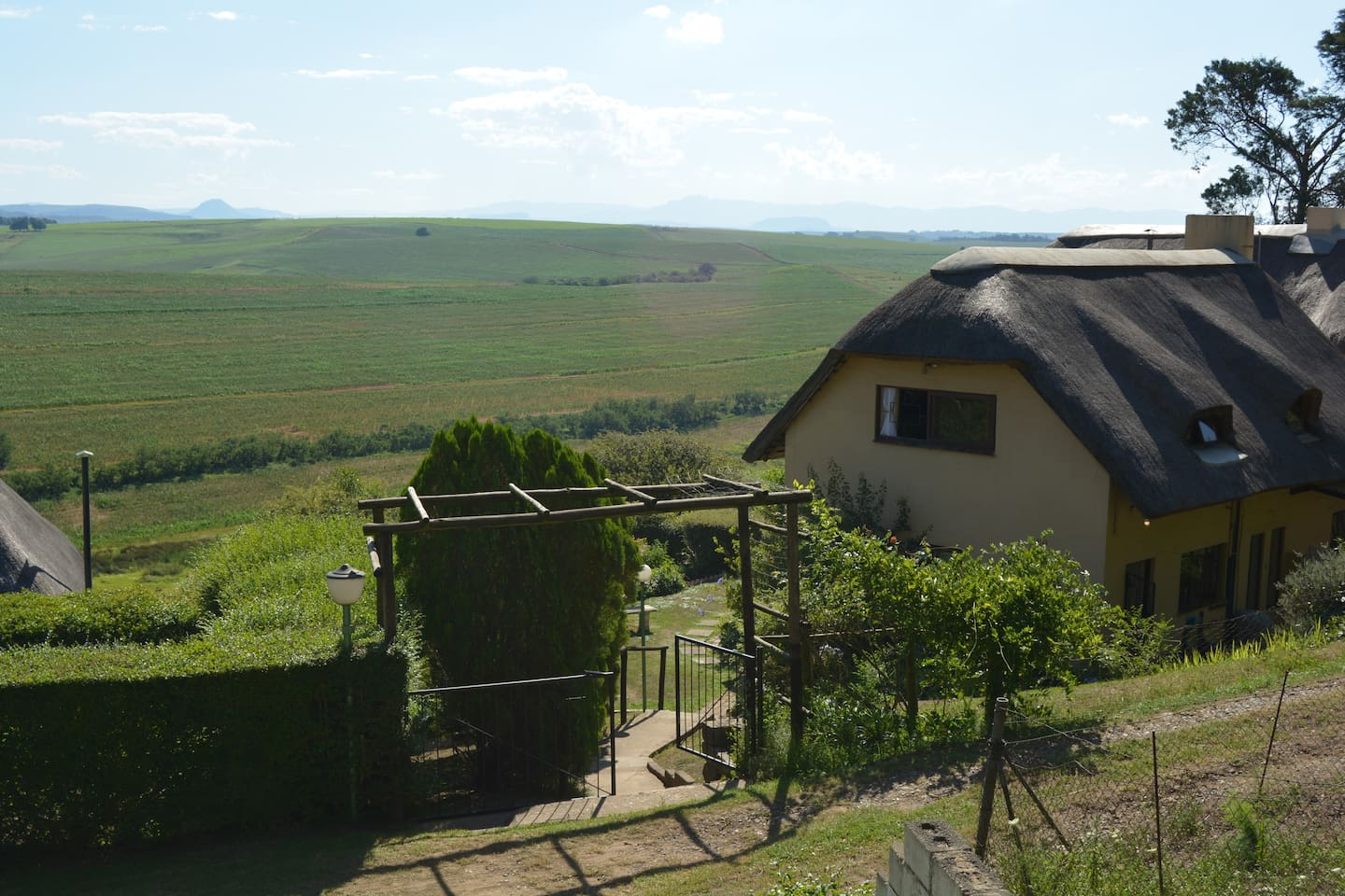 Photo of rear view of guest lodge  and Drakensberg Mountains