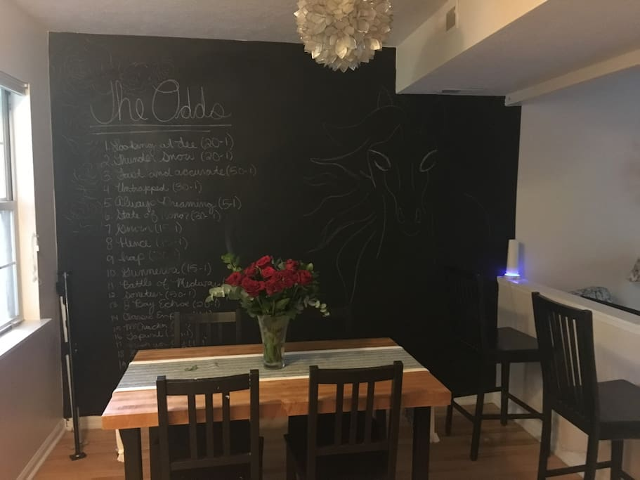 Dining room with chalkboard wall--feel free to create your own art or leave us a message! Table has been updated to larger table with four more chairs!