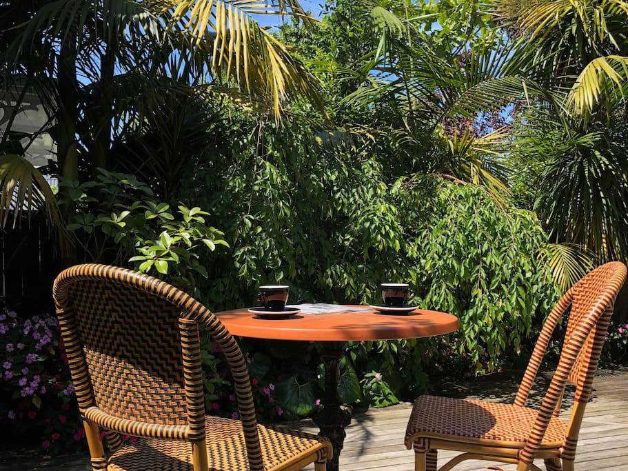 Start the day enjoying your breakfast coffee on the deck in our beautiful tropical garden.