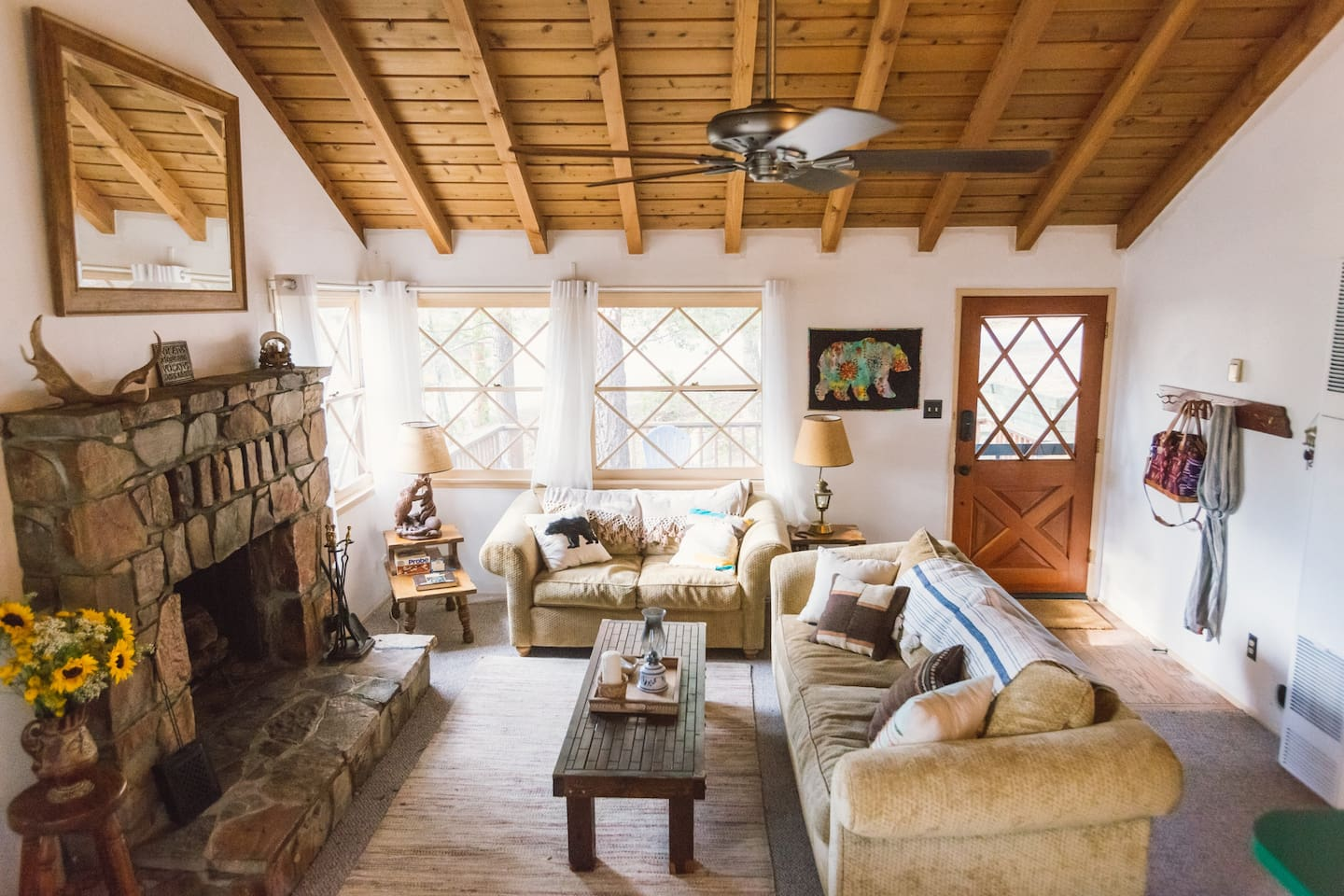 Super cozy living room with huge vaulted ceilings make this little cabin the perfect place to find a respite from city life.