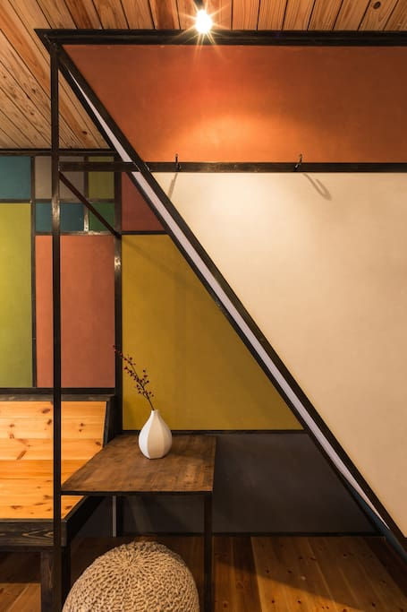 "The gallery interior features a ""mondrian"" style design created by a kyoto artisan carpenter."
