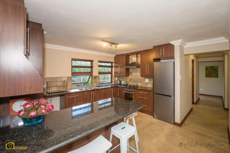 Stylish modern open plan kitchen with breakfast nook