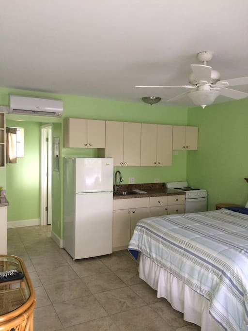 Each Studio has a queen size bed w/ a small kitchen, a mini-split AC, WiFi, Flat screen TV and parking right out side your door!!