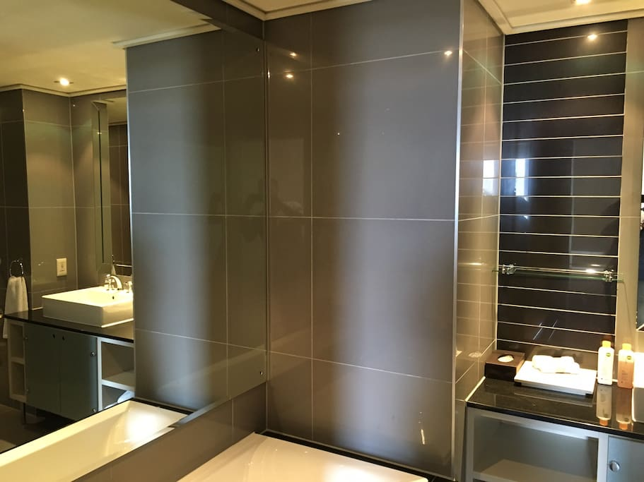 two of the 3 bathrooms have a bathtub...