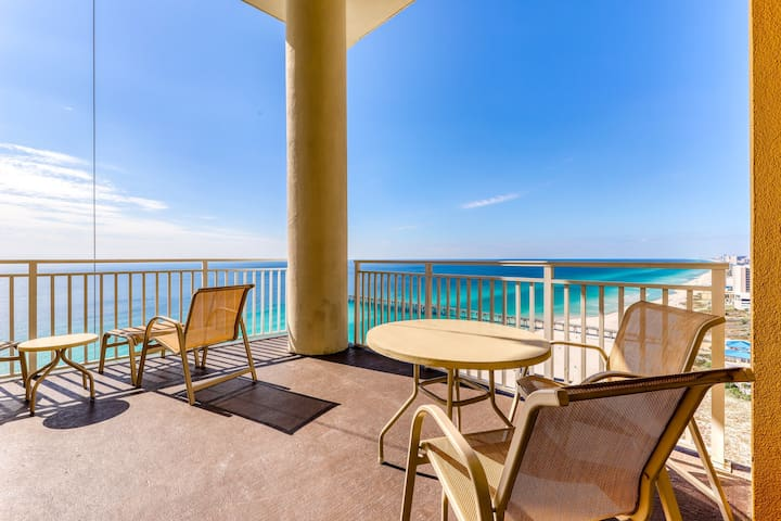 High-end beachfront condo w/ shared pools and gym! Walk to the beach!