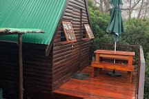 Each cabin has its own deck with umbrella, chairs with cushions