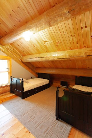 Upstairs bedroom with twin trundle beds.
