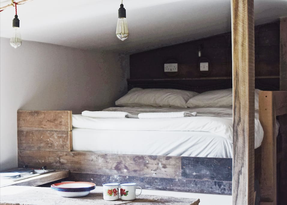 Handcrafted double bed from reclaimed wood and railway sleepers