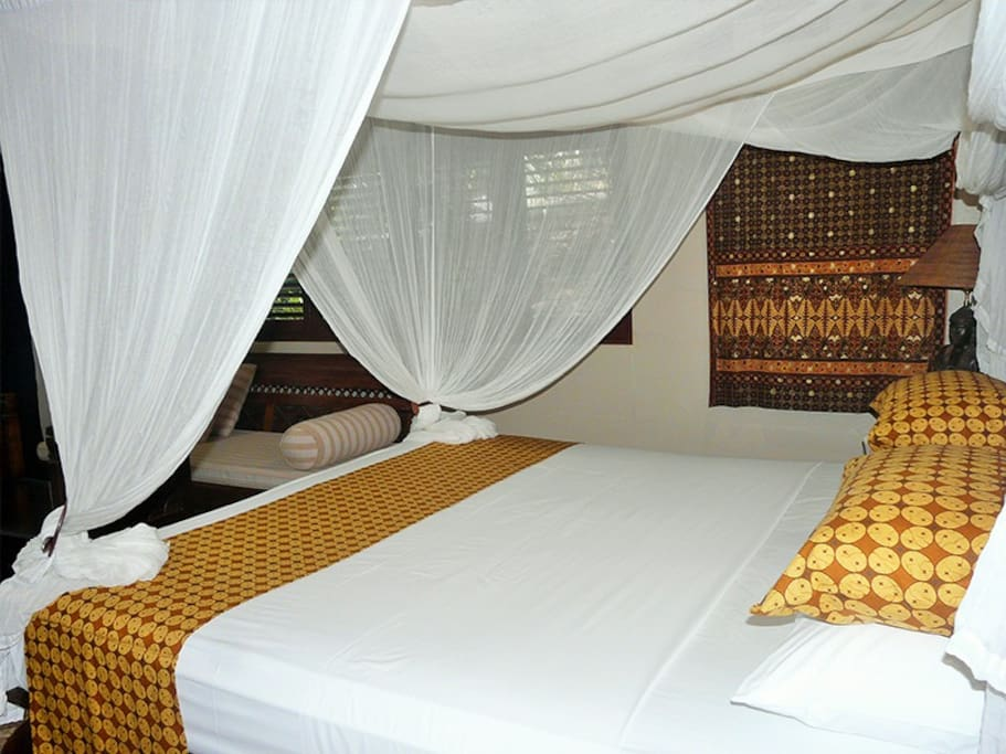 Deluxe Room (Lotus Room) with tropical outdoor shower and private garden.
