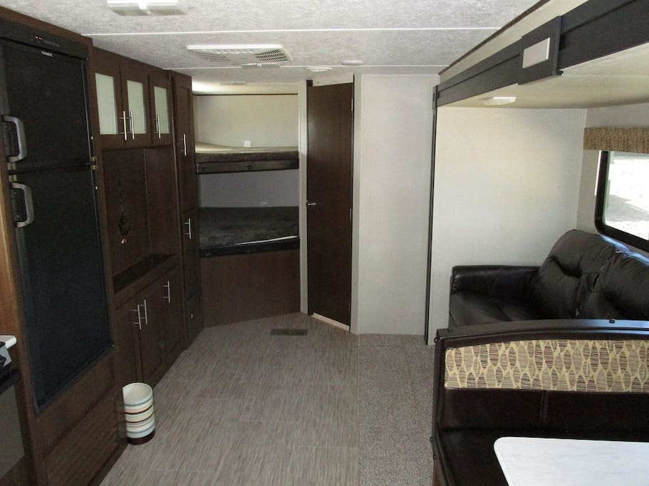 2 BUNKS IN BACK, PULL OUT COUCH ON RIGHT, BATH AT DOOR,