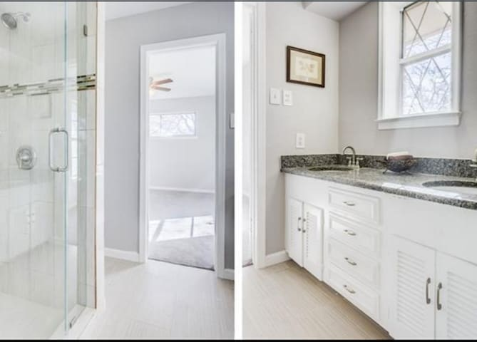 New shared bathroom with glass shower and granite counters